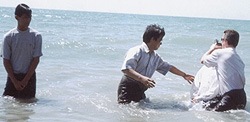 Paul baptizing Bible School students in Burma (Myanmar).