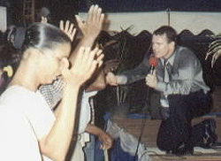 Paul praying for people in Guyana.