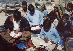 Villagers in India eagerly study the Bible.
