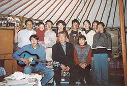 Mongolia friends in a ger (traditional hut) with Paul.