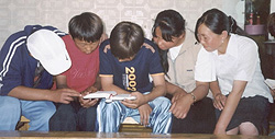 Mongolian youth eagerly reading the Bible.