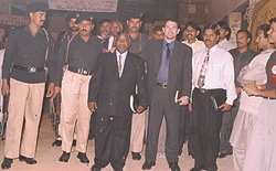 Paul with his entourage of Pakistan police for security measures taken during a tense time in the nation following the execution in America of a Pakistani national who had killed two CIA agents.
