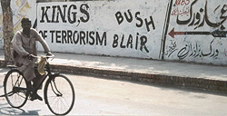 Sign along the wall in Karachi declaring the true kings of terrorism.