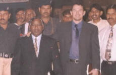 Paul with his entourage of Pakistan police for security measures taken during a tense time in the nation following the execution in America of a Pakistani national who had killed two CIA agents