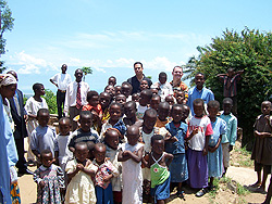 Paul & Isai in the mountains of Burundi, East Africa with several youth from a village.