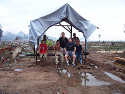 Paul & Isai underneath and temporary shelter while they began rebuilding a home destroyed by the tsunamis in Indonesia